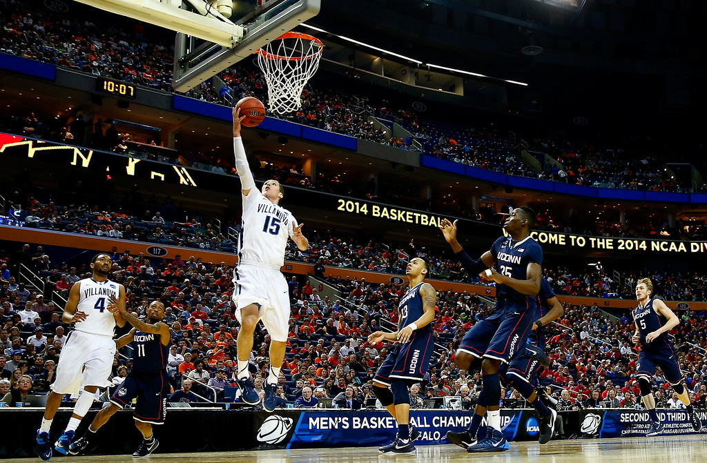 . BUFFALO, NY - MARCH 22: Ryan Arcidiacono #15 of the Villanova Wildcats goes up for a layup against the Connecticut Huskies during the third round of the 2014 NCAA Men\'s Basketball Tournament at the First Niagara Center on March 22, 2014 in Buffalo, New York.  (Photo by Jared Wickerham/Getty Images)