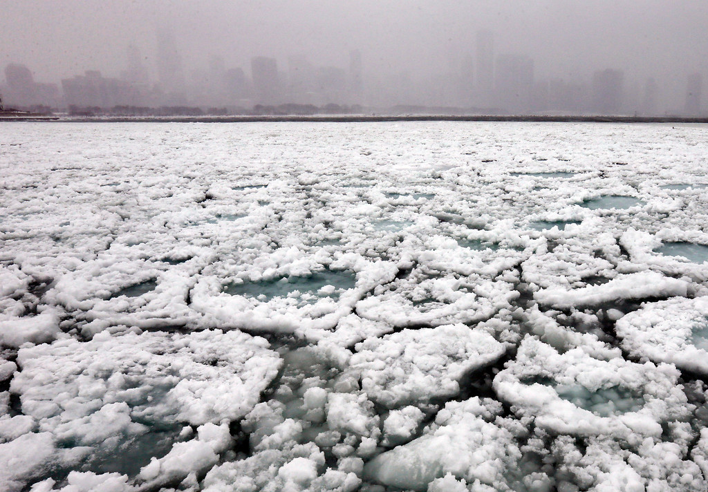 . The Chicago skyline and a freezing Lake Michigan are seen from the Museum Campus in Chicago on Sunday, Jan. 5, 2014. Sunday night temperatures will drastically drop to about minus 20 degrees. (AP Photo/Nam Y. Huh)