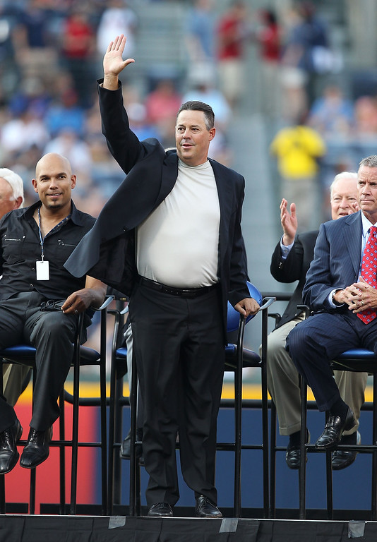 . Former Atlanta Braves pitcher Greg Maddux acknowledges the crowd during the Bobby Cox number retirement ceremony before the game between the Atlanta Braves and the Chicago Cubs at Turner Field on August 12, 2011 in Atlanta, Georgia.  (Photo by Mike Zarrilli/Getty Images)