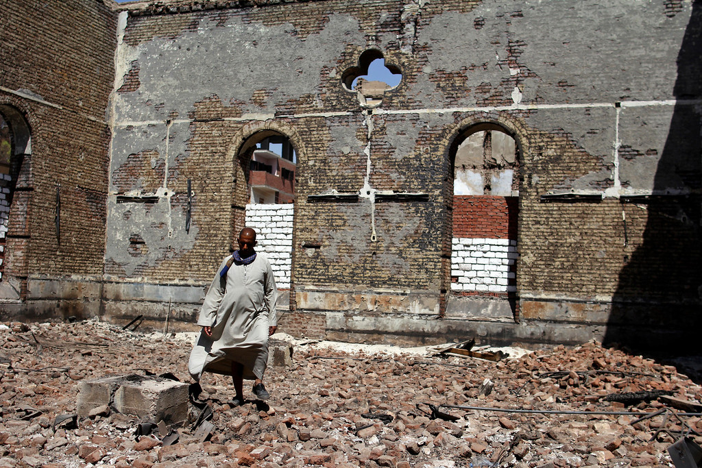 . In this Sept. 3, 2013 photo, a guard walks in the damaged Evangelical Church of Malawi that was looted and burned by Islamists, in Malawi, Minya province, Egypt. With the Egyptian army and police already fighting a burgeoning Islamist insurgency in the strategic Sinai peninsula near the border with Gaza and Israel, there are growing signs that a second insurgency could erupt in the Nile-side Minya province and Assiut to the south -- both strongholds of Islamists and home to Egypt\'s two largest Christian communities. (AP Photo/El Shorouk Newspaper, Roger Anis)