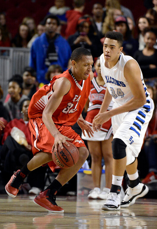 . DENVER, CO. - FEBRUARY 09: Tyre Robinson (32) of East drives on Zach Braxton (34) of Highlands Ranch February 9, 2012 at Magness Arena.  East defeated Highlands Ranch 73 - 54. (Photo By John Leyba/The Denver Post)