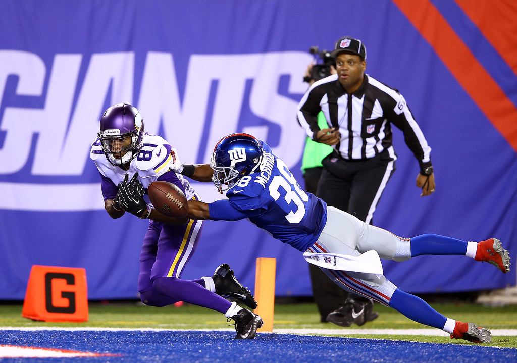 . Wide receiver Jerome Simpson #81 of the Minnesota Vikings cannot make the catch as cornerback Trumaine McBride #38 of the New York Giants defends during a game at MetLife Stadium on October 21, 2013 in East Rutherford, New Jersey.  (Photo by Al Bello/Getty Images)