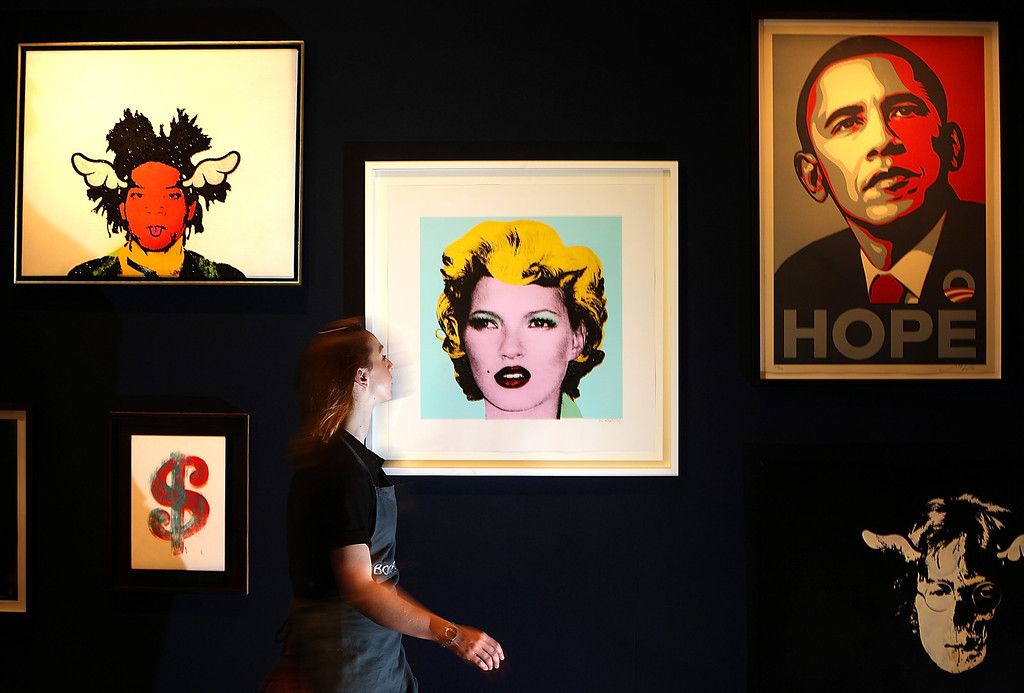 . Employee Victoria Livesey walks past Banksy\'s \'Kate Moss 2005\' on display at Bonhams on March 23, 2012 in London, England.  The painting, estimated at GBP 30,000 - 50,000, USD 48,000 - 79,000 and 35,000 - 59,000 euros forms part of the Urban Art Sale, which takes place at Bonhams on March 29, 2012.  (Photo by Peter Macdiarmid/Getty Images)
