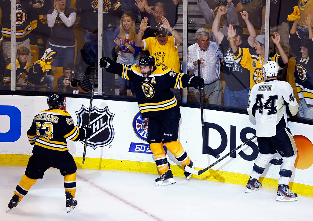 . Patrice Bergeron #37 of the Boston Bruins reacts after scoring the game winning goal in double overtime to defeat the Pittsburgh Penguins 2-1 in Game Three of the Eastern Conference Final of the 2013 NHL Stanley Cup Playoffs at the TD Garden on June 5, 2013 in Boston, Massachusetts.  (Photo by Jared Wickerham/Getty Images)