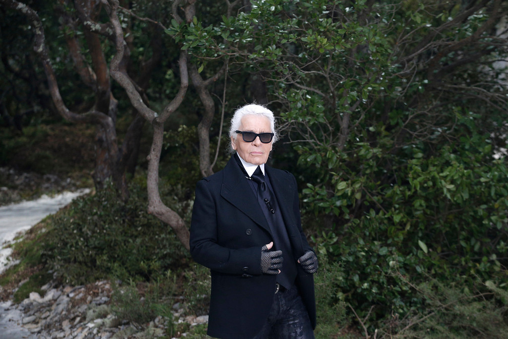 . German fashion designer Karl Lagerfeld appears after the presentation of Chanel\'s Spring Summer 2013 Haute Couture fashion collection, presented in Paris, Tuesday, Jan.22, 2013. (AP Photo/Christophe Ena)