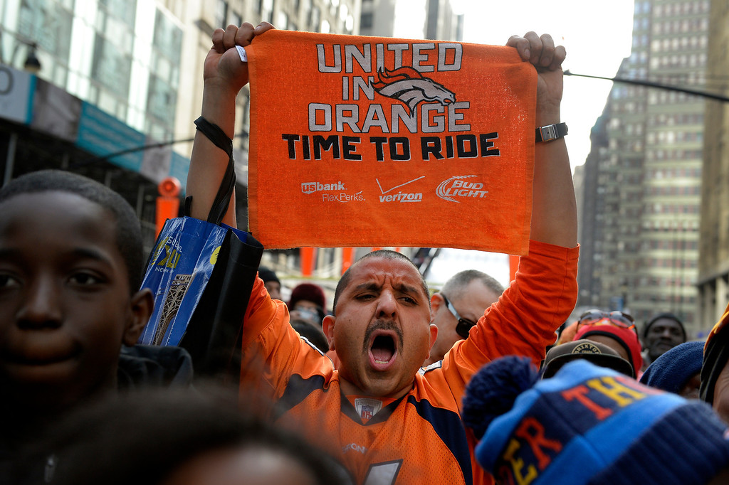 ". Broncos fan Antonio Acosta, aka ""Broncos Tiz,\"" of Colorado Springs cheers for the Broncos while watching the Press Box Tailgating Show on Super Bowl Boulevard in New York, NY February 02, 2014. The NFL has transformed 13 blocks of Broadway into a center for Super Bowl activity before Sundays Super Bowl between the Denver Broncos and Seattle Seahawks. Acosta predicted a 38-17 victory for the Broncos.  (Photo By Craig F. Walker / The Denver Post)"