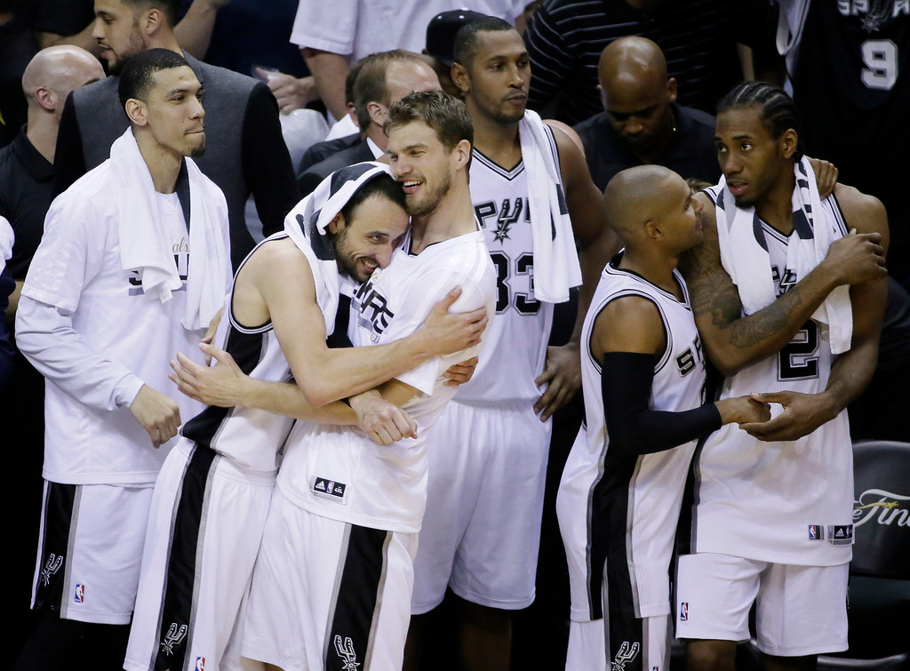 . San Antonio Spurs players from left, Danny Green, Manu Ginobili, Tiago Splitter, Boris Diaw, Patty Mills, and Kawhi Leonard celebrate in the final moments at Game 5 of the NBA basketball finals on Sunday, June 15, 2014, in San Antonio. San Antonio won the NBA championship 104-87. (AP Photo/Tony Gutierrez)
