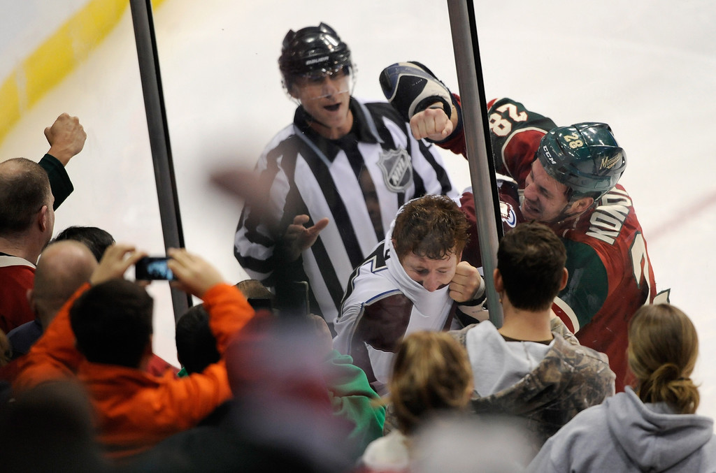 . ST PAUL, MN - JANUARY 19:  Fans cheer as Zenon Konopka #28 of the Minnesota Wild and Cody McLeod #55 of the Colorado Avalanche fight during the first period of their home opener January 19, 2013 at Xcel Energy Center in St Paul, Minnesota. (Photo by Hannah Foslien/Getty Images)