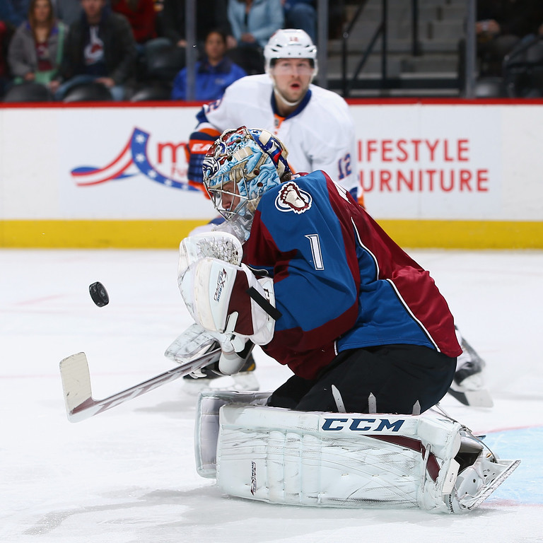 . DENVER, CO - JANUARY 10:  Goalie Semyon Varlamov #1 of the Colorado Avalanche turns the puck away as Josh Bailey #12 of the New York Islanders follows the play at Pepsi Center on January 10, 2014 in Denver, Colorado.  (Photo by Doug Pensinger/Getty Images)
