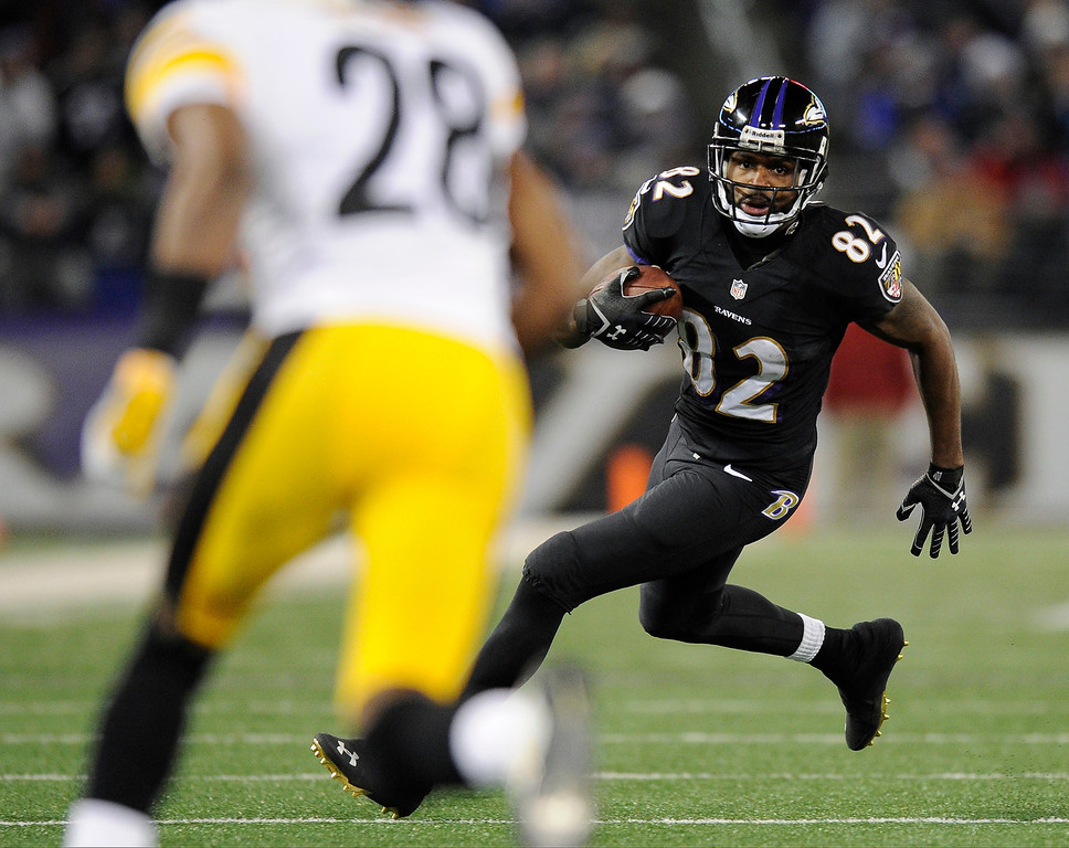 . Baltimore Ravens wide receiver Torrey Smith (82) rushes the ball toward Pittsburgh Steelers cornerback Cortez Allen in the second half of an NFL football game on Thursday, Nov. 28, 2013, in Baltimore. (AP Photo/Nick Wass)