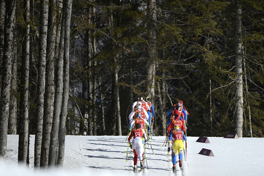 . Athletes compete in the Women\'s Cross-Country Skiing 4x5km Relay at the Laura Cross-Country Ski and Biathlon Center during the Sochi Winter Olympics on February 15, 2014, in Rosa Khutor, near Sochi.      PIERRE-PHILIPPE MARCOU/AFP/Getty Images