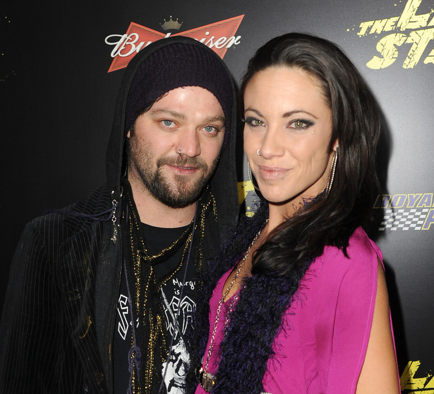 ". Actor Bam Margera (L) and Nicole Boyd arrive at the premiere of Lionsgate Films\' ""The Last Stand\"" at Grauman\'s Chinese Theatre on January 14, 2013 in Hollywood, California.  (Photo by Kevin Winter/Getty Images)"