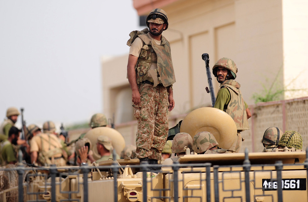 . Pakistani army personnel stand guard in armoured vehicles after a search operation following an assault by militants at Karachi airport terminal in Karachi on June 9, 2014.  AFP PHOTO/Rizwan TABASSUM/AFP/Getty Images