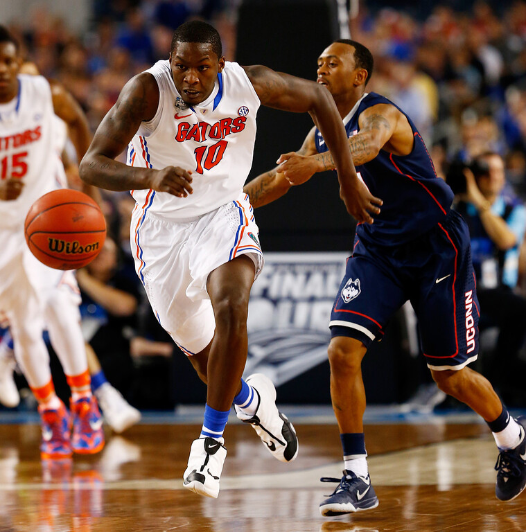. ARLINGTON, TX - APRIL 05: Dorian Finney-Smith #10 of the Florida Gators tries to control the ball as Ryan Boatright #11 of the Connecticut Huskies defends during the NCAA Men\'s Final Four Semifinal at AT&T Stadium on April 5, 2014 in Arlington, Texas.  (Photo by Tom Pennington/Getty Images)
