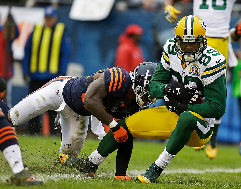 . Green Bay Packers wide receiver James Jones (89) crosses the goal line with a touchdown reception while tackled by Chicago Bears cornerback D.J. Moore in the first half of an NFL football game in Chicago, Sunday, Dec. 16, 2012. (AP Photo/Nam Y. Huh)