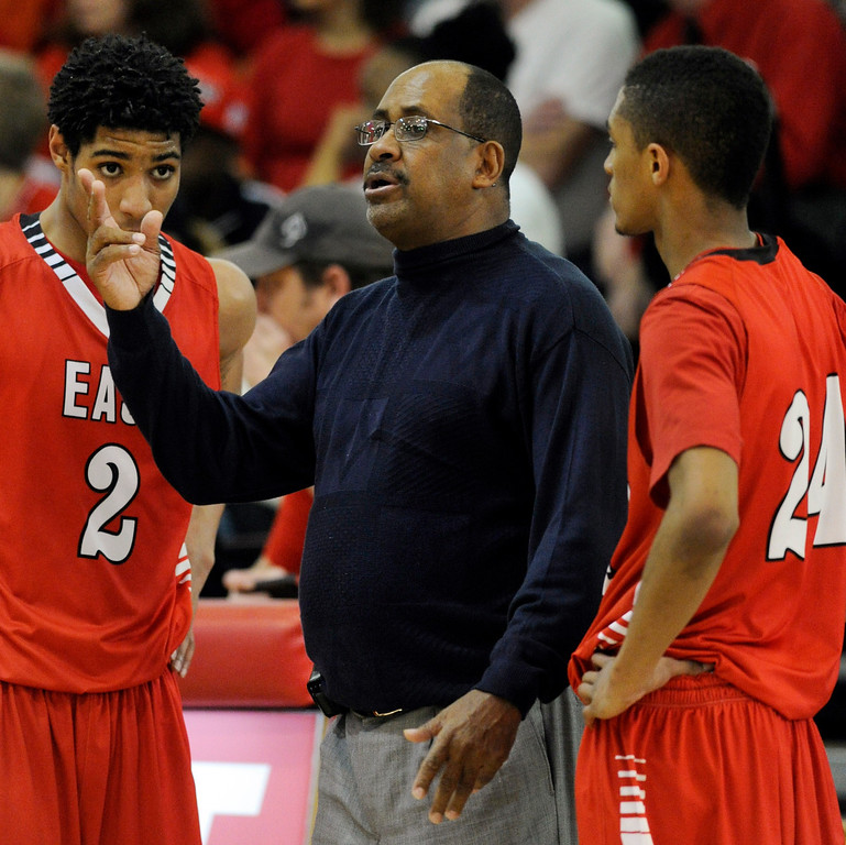 . DENVER, CO. - FEBRUARY 16: Angels coach Rudy Carey made a point with guards Jevon Griffin (2) and Dominique Collier (24) in the second half. The Denver East High School boy\'s basketball team defeated George Washington 82-20 Saturday afternoon, February 16, 2013.  (Photo By Karl Gehring/The Denver Post)