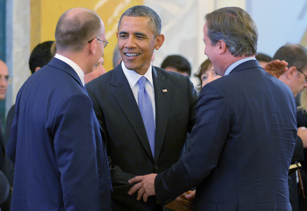 . In this handout image provided by Host Photo Agency, (L to R) Italian Prime Minister Enrico Letta, U.S. President Barack Obama and British Prime Minister David Cameron talk during the first working meeting of the G20 summit on September 5, 2013 in St. Petersburg, Russia.  The G20 summit is expected to be dominated by the issue of military action in Syria while issues surrounding the global economy, including tax avoidance by multinationals, will also be discussed during the two-day summit.  (Photo by Alexei Danichev/Host Photo Agency via Getty Images)