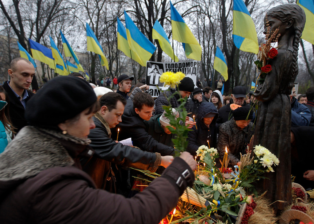 . People light candles during a ceremony to commemorate victims of the 1932-33 Great Famine in Kiev, Ukraine, Saturday, Nov. 23, 2013. AP Photo/Sergei Chuzavkov)