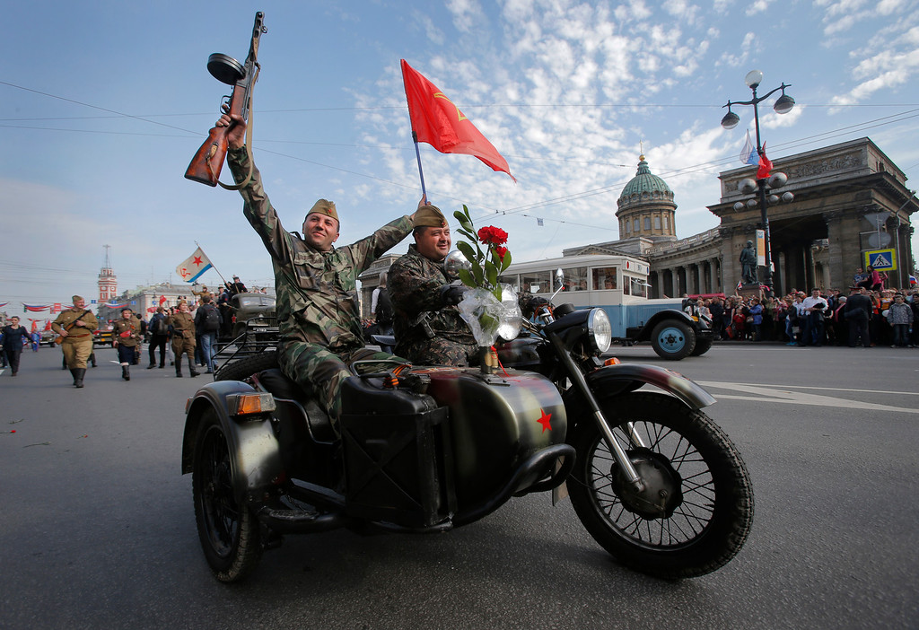 . Members of a historical military club wearing Soviet army uniforms ride during celebration of the Victory Day in St.Petersburg, Russia, Thursday, May 9, 2013. Russia is celebrating the anniversary of victory over Germany in WWII. (AP Photo/Dmitry Lovetsky)