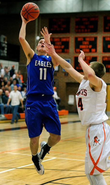 . Eagles\' guard Spenser Reeb (22) drove to the basket in the first half Friday night. The Lewis-Palmer High School boy\'s basketball team hosted Broomfield Friday night,December 7, 2012.  Karl Gehring/The Denver Post