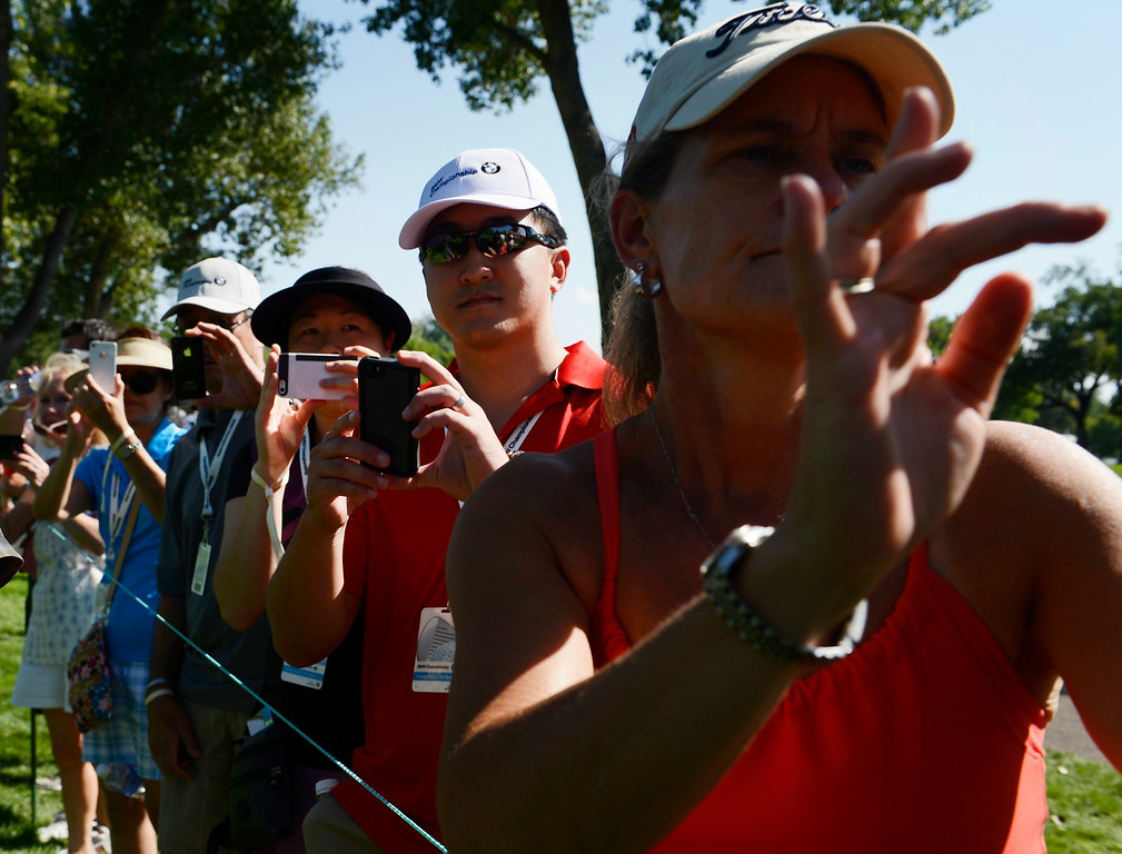 . CHERRY HILLS VILLAGE, CO. - SEPTEMBER 02:  Golf fans try to get snap shots of professional golfer, Rory McIIroy, during a practice round at the FedExCup BMW Championship at the Cherry Hills Country Club Tuesday, September 02, 2014. (Photo By Andy Cross / The Denver Post)
