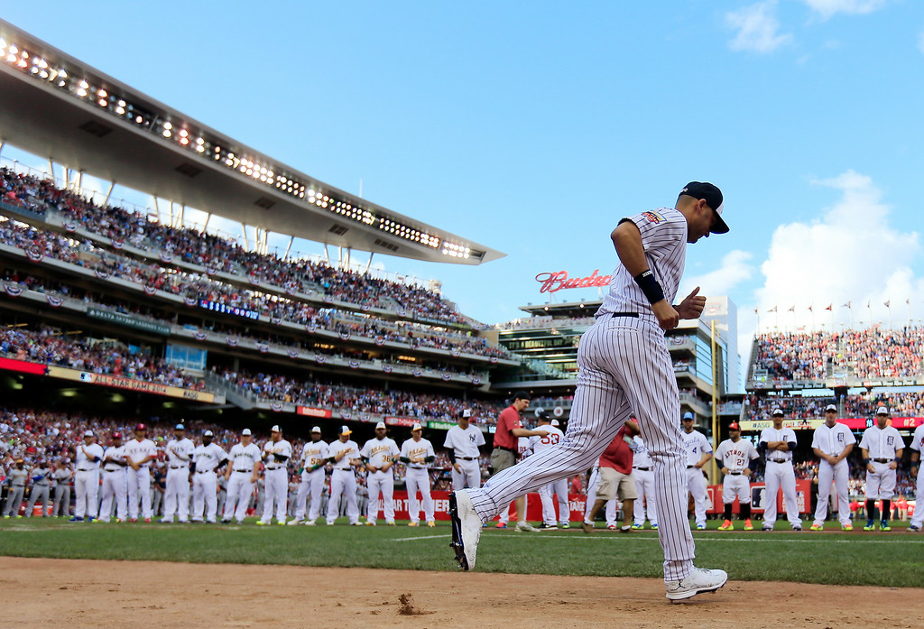 . American League All-Star Derek Jeter #2 of the New York Yankees is introduced prior to the 85th MLB All-Star Game at Target Field on July 15, 2014 in Minneapolis, Minnesota.  (Photo by Rob Carr/Getty Images)