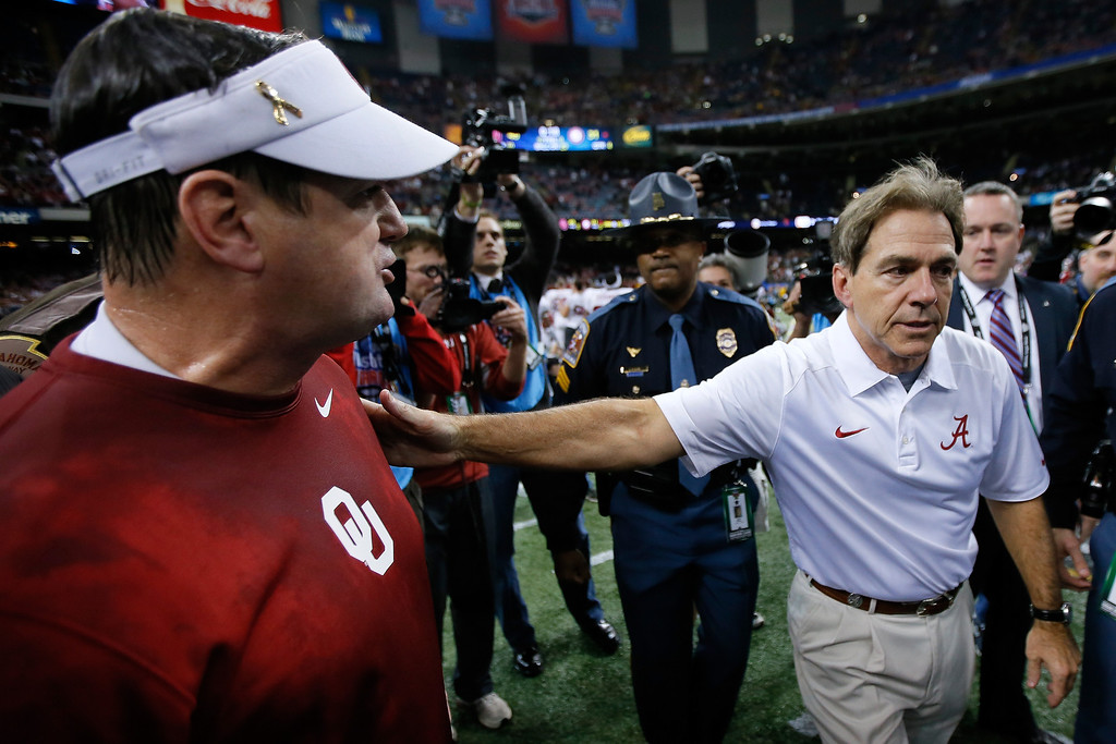 . NEW ORLEANS, LA - JANUARY 02:  Head coach Bob Stoops of the Oklahoma Sooners is congratulated by Nick Saban, head coach of the Alabama Crimson Tide during the Allstate Sugar Bowl at the Mercedes-Benz Superdome on January 2, 2014 in New Orleans, Louisiana.  (Photo by Kevin C. Cox/Getty Images)