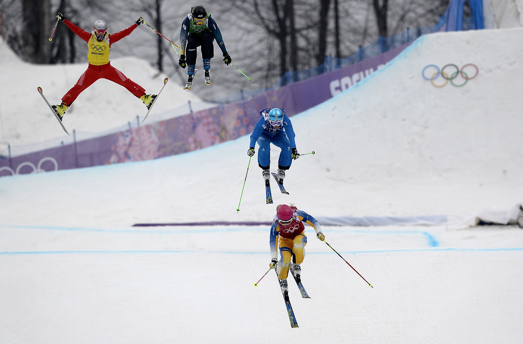 . Skiers race in the Women\'s Freestyle Skiing Ski Cross Small Final at the Rosa Khutor Extreme Park during the Sochi Winter Olympics on February 21, 2014. AFP PHOTO / FRANCK FIFE/AFP/Getty Images