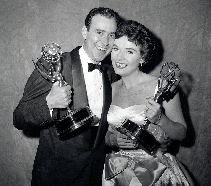 ". Writer Carl Reiner and actress Polly Bergen pose with their statuettes at the Emmy Awards presentations in New York City, April 15, 1958.  Reiner won for best continuing supporting performance by an actor in a dramatic or comedy series for ""Caesar\'s Hour.\""  Bergen won best single performance by an actress in a lead or support role for \""Playhouse 90:  Helen Morgan Story.\""  (AP Photo)"