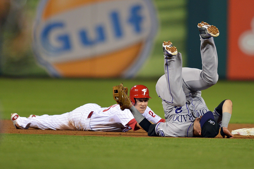 . Troy Tulowitzki #2 of the Colorado Rockies rolls over after tagging out Chase Utley #26 of the Philadelphia Phillies in the eighth inning at Citizens Bank Park on August 20, 2013 in Philadelphia, Pennsylvania. The Rockies won 5-3. (Photo by Drew Hallowell/Getty Images)