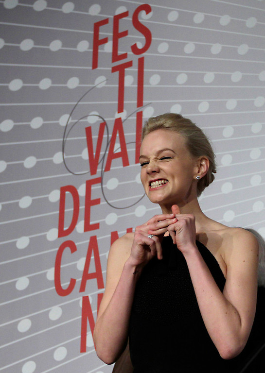 . Actress Carey Mulligan gestures to the journalists prior to a press conference for the film The Great Gatsby at the 66th international film festival, in Cannes, southern France, Wednesday, May 15, 2013. (AP Photo/Virginia Mayo)