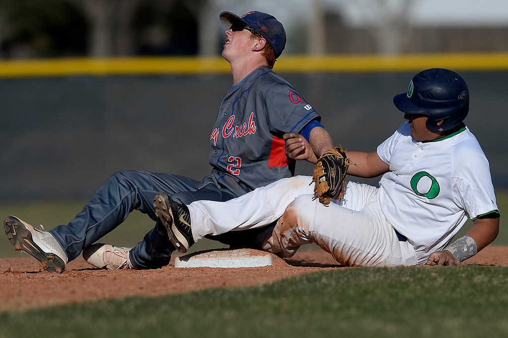 . Aurora, CO - APRIL 08: Eric Salas (4) of the Overland Trailblazers slides into Ryan Robb (2) of the Cherry Creek Bruins during the sixth inning. Overland hosted Cherry Creek on Tuesday, April 8, 2014. (Photo by AAron Ontiveroz/The Denver Post)