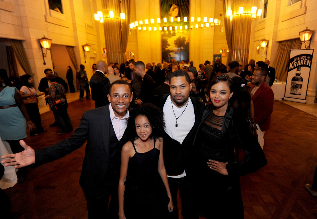 """. (L-R) Actor Hill Harper, actress Troi Zee, director Tommy Oliver, and actress Sharon Leal  attend the \""""1982\"""" Reception during the 2013 Toronto International Film Festival at Windsor Arms Hotel on September 8, 2013 in Toronto, Canada.  (Photo by Jag Gundu/Getty Images for PMKBNC)"""