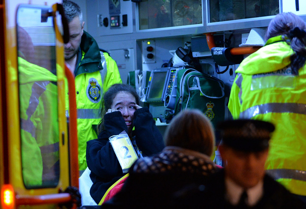 . An injured woman cries inside an ambulance following a ceiling collapse at a theatre in Central London on December 19, 2013.   AFP PHOTO/LEON NEAL/AFP/Getty Images