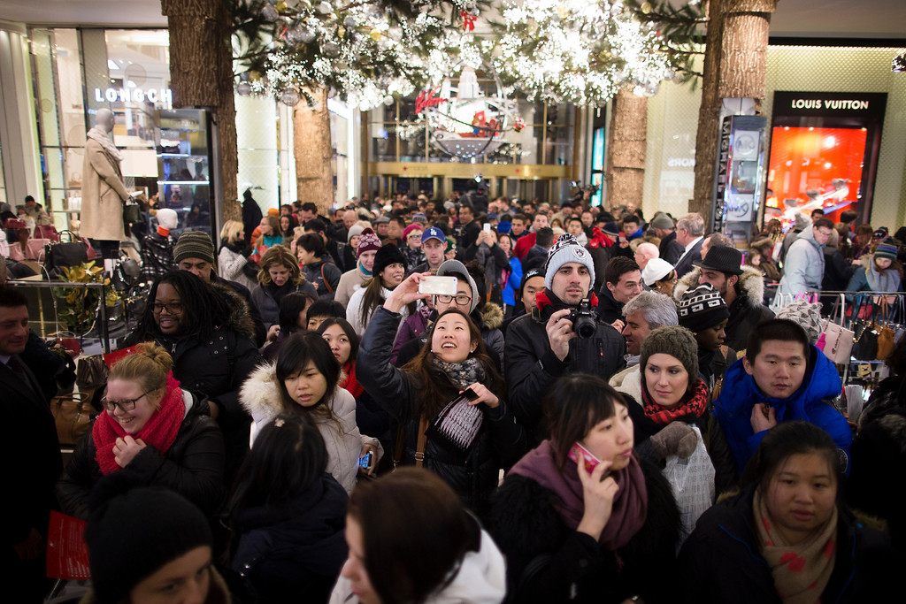 . A shopper takes a selfie as crowds pour into the Macy\'s Herald Square flagship store, Thursday, Nov. 28, 2013, in New York. Instead of waiting for Black Friday, which is typically the year\'s biggest shopping day, more than a dozen major retailers are opening on Thanksgiving this year. (AP Photo/John Minchillo)