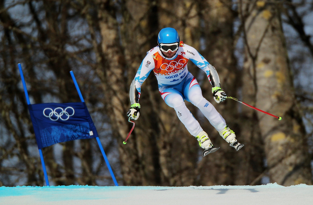 . Georg Streitberger of Austria skis during the Alpine Skiing Men\'s Super-G on day 9 of the Sochi 2014 Winter Olympics at Rosa Khutor Alpine Center on February 16, 2014 in Sochi, Russia.  (Photo by Clive Rose/Getty Images)