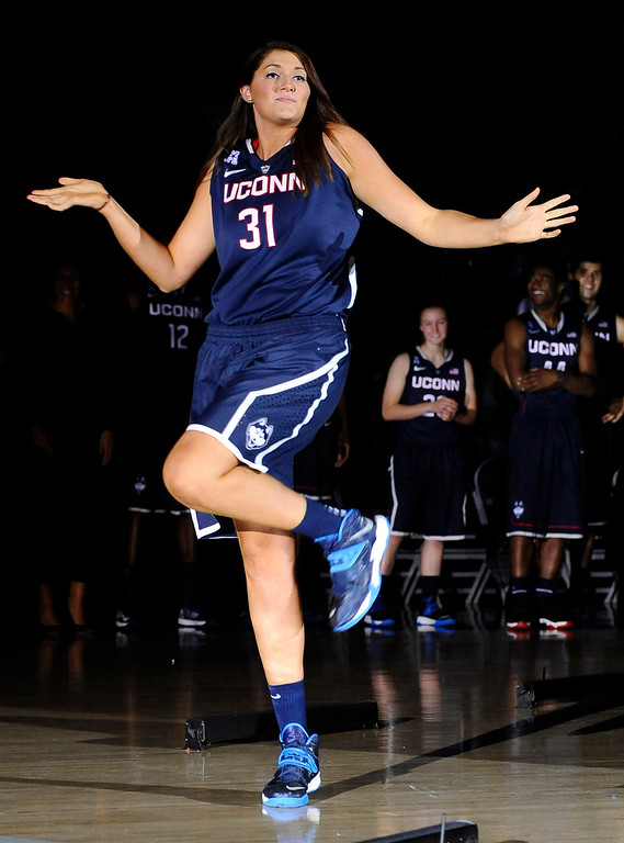 . Connecticut\'s Stefanie Dolson dances as she is introduced at the men\'s and women\'s basketball teams\' First Night event Friday, Oct. 18, 2013, in Storrs, Conn. (AP Photo/Jessica Hill)