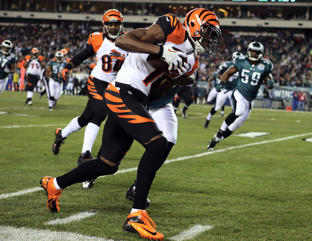 . A.J. Green #18 of the Cincinnati Bengals carries the ball in the first quarter against the Philadelphia Eagles on December 13, 2012 at Lincoln Financial Field in Philadelphia, Pennsylvania.  (Photo by Elsa/Getty Images)