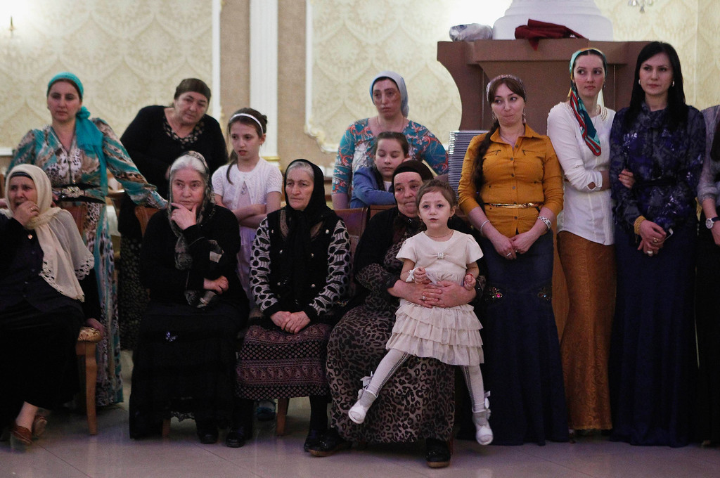 . Women watch dancing at a wedding party in the Chechen capital Grozny April 24, 2013. The naming of two Chechens, Dzhokhar and Tamerlan Tsarnaev, as suspects in the Boston Marathon bombings has put Chechnya - the former site of a bloody separatist insurgency - back on the world\'s front pages. Chechnya appears almost miraculously reborn. The streets have been rebuilt. Walls riddled with bullet holes are long gone. New high rise buildings soar into the sky. Spotless playgrounds are packed with children. A giant marble mosque glimmers in the night. Yet, scratch the surface and the miracle is less impressive than it seems. Behind closed doors, people speak of a warped and oppressive place, run by a Kremlin-imposed leader through fear.    Picture taken April 24, 2013.   REUTERS/Maxim Shemetov