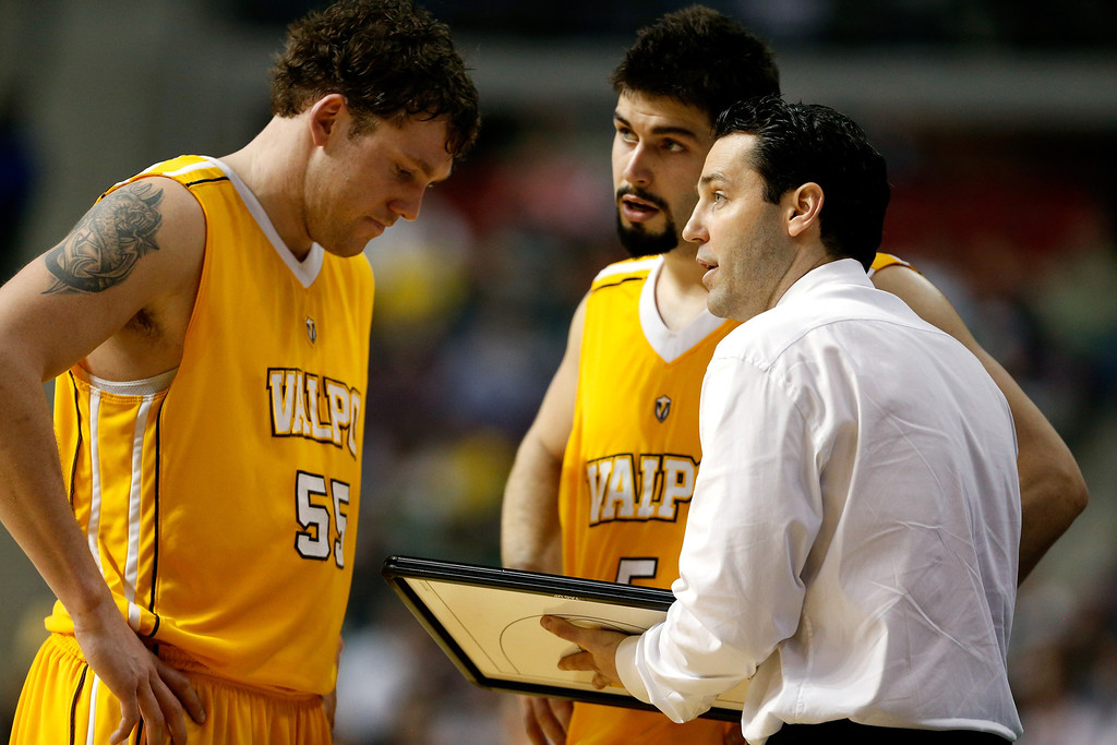 . Head coach Bryce Drew of the Valparaiso Crusaders talks with Kevin Van Wijk #55 (L) and Bobby Capobianco #5 against the Michigan State Spartans during the second round of the 2013 NCAA Men\'s Basketball Tournament at at The Palace of Auburn Hills on March 21, 2013 in Auburn Hills, Michigan.  (Photo by Gregory Shamus/Getty Images)