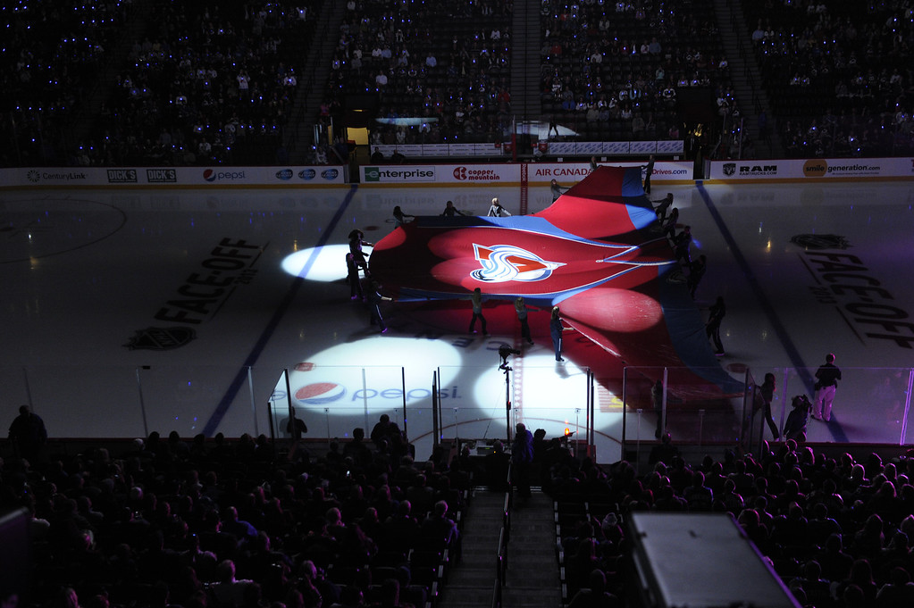 . DENVER, CO. - OCTOBER 02: A giant Avalanche jersey was skated out onto the ice before the first period. The Colorado Avalanche hosted the Anaheim Ducks at the Pepsi Center Wednesday night, October 2, 2013. Photo By Karl Gehring/The Denver Post