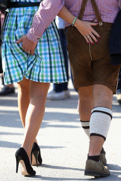 . Revelers dressed in traditional Bavarian clothing attend the Oktoberfest on September 21, 2013 in Munich, Germany. The Munich Oktoberfest, which this year will run from September 21 through October 6, is the world\'s largest beer fest and draws millions of visitors.  (Photo by Alexander Hassenstein/Getty Images)