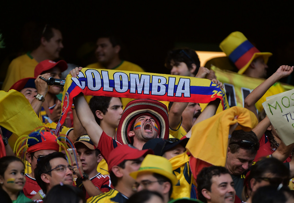 . Colombia\'s fans cheer before the quarter-final football match between Brazil and Colombia at the Castelao Stadium in Fortaleza during the 2014 FIFA World Cup on July 4, 2014. GABRIEL BOUYS/AFP/Getty Images