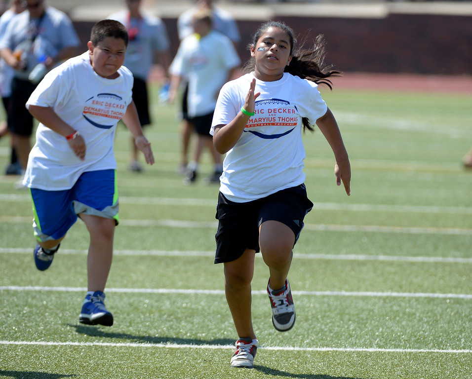 . Naagli Herrera 11 heads to the finish line during a race at football camp. Demaryius Thomas and Eric Decker team up with ProCamps for their football camp held at Littleton High School July 11, 2013. (Photo By John Leyba/The Denver Post)