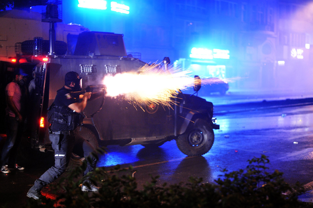 . Riot police fires tear gas bomb to disperse protesters at Harbiye near Taksim square in Istanbul, on June 16, 2013. Police fired tear gas and jets of water to disperse hundreds of demonstrators in Istanbul\'s Taksim Square, shortly after Turkish Prime Minister Recep Tayyip Erdogan warned police would intervene to end protesters\' occupation of a park bordering the square. Turkish protesters today had refused to budge from an Istanbul park at the centre of nationwide anti-government demonstrations after rejecting a government olive branch aimed at ending two weeks of deadly unrest.     OZAN KOSE/AFP/Getty Images
