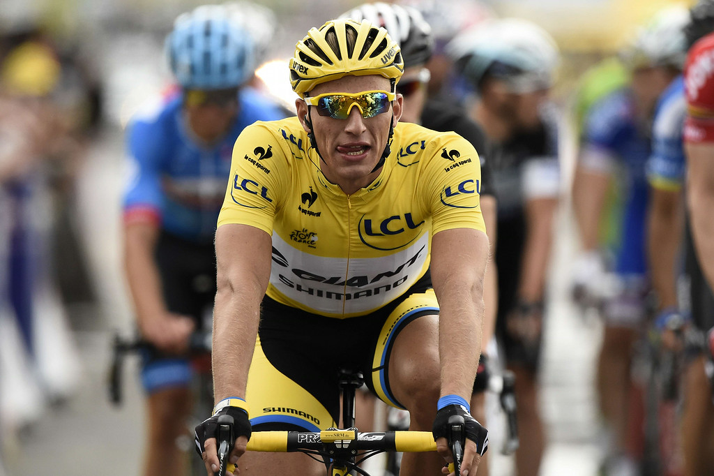 . Germany\'s Marcel Kittel wearing the overall leader\'s yellow jersey crosses the finish line at the end of the 201 km second stage of the 101th edition of the Tour de France cycling race on July 6, 2014 between York and Sheffield, northern England.  AFP PHOTO / LIONEL BONAVENTURELIONEL BONAVENTURE/AFP/Getty Images