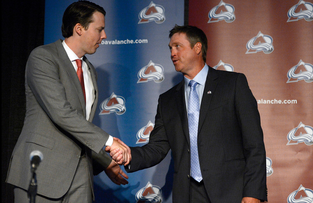 . Patrick Roy, Head Coach/Vice President of Hockey Operations shakes hands with Avalanche President Josh Kroenke after their press conference. The Colorado Avalanche announced Patrick Roy as their new head coach/vice president of hockey operations May 28, 2013 at Pepsi Center. This will make Roy the sixth  head coach in Avalanche history since coming to Denver. (Photo By John Leyba/The Denver Post)