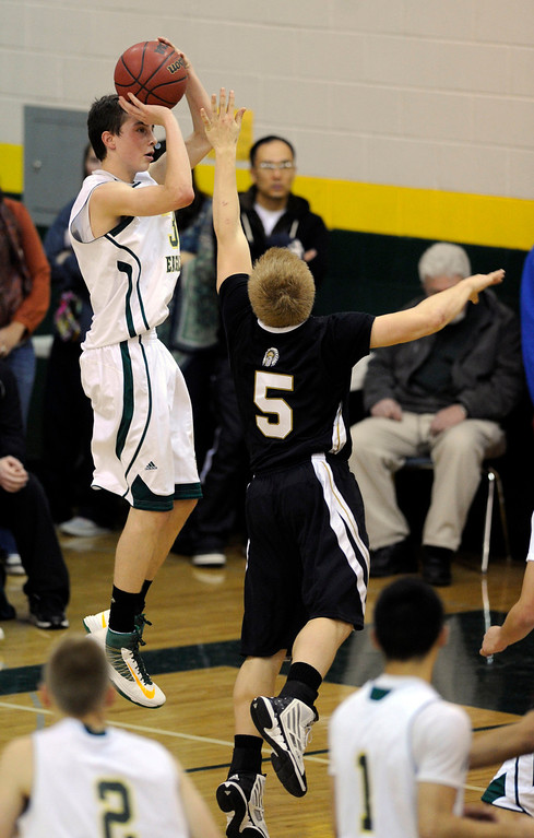 . Mountain Vista guard Jake Pemberton (3) took a jump shot over Arapahoe defender Blake Nelson (5) in the second half. The Mountain Vista High School boy\'s basketball team defeated Arapahoe 69-54 Friday night January 4, 2013.  Karl Gehring/The Denver Post