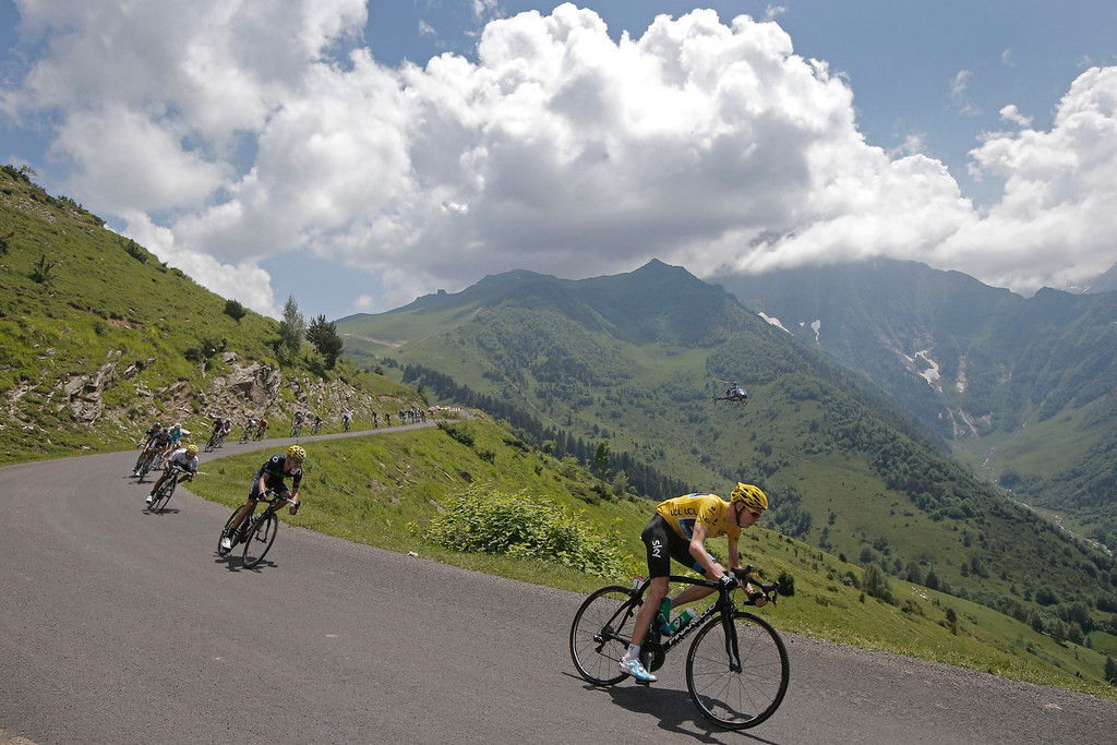 . Christopher Froome of Britain, wearing the overall leader\'s yellow jersey, and Nairo Alexander Quintana of Colombia, wearing the best young rider\'s white jersey, in third position, speed down Val Louron-Azet pass during the ninth stage of the Tour de France cycling race over 168.5 kilometers (105.3 miles) with start in Saint-Girons and finish in Bagneres-de-Bigorre, Pyrenees region, France, Sunday July 7, 2013. (AP Photo/Laurent Cipriani, File)