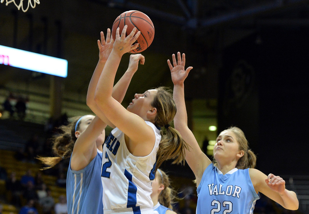 . Broomfield\'s Stacie Hull goes to the basket  against Valor Christian\'s Caroline Bryan and Madi Waldon during the final four 4A state game at Coors Event Center. (David R. Jennings/Broomfield Enterprise)